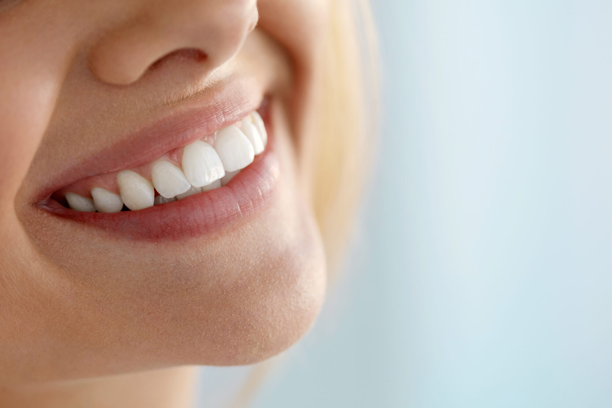 woman shows off her new teeth after visiting Cosmetic Dentist Miami
