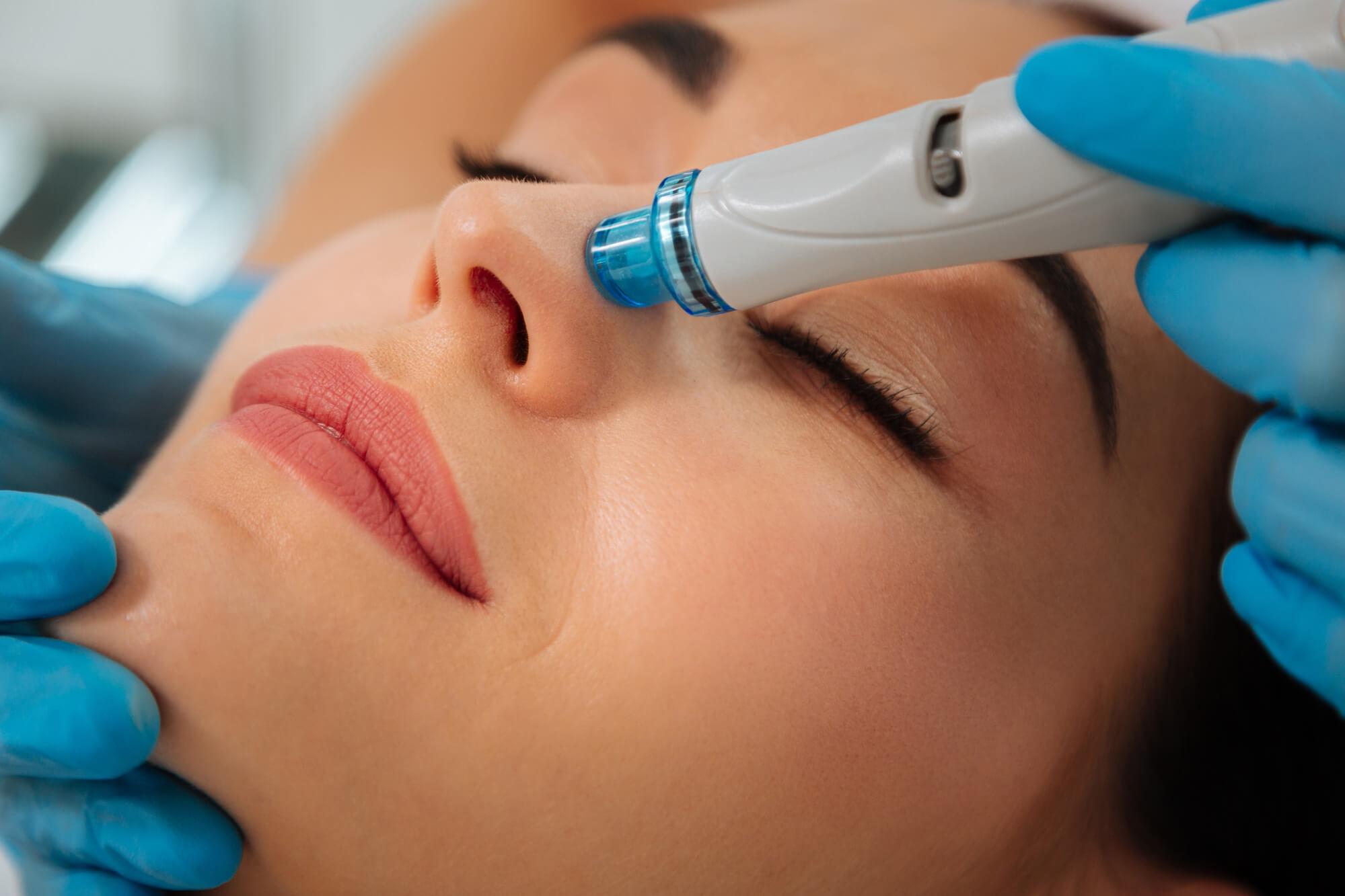 woman receiving a hydrafacial treatment in Miami