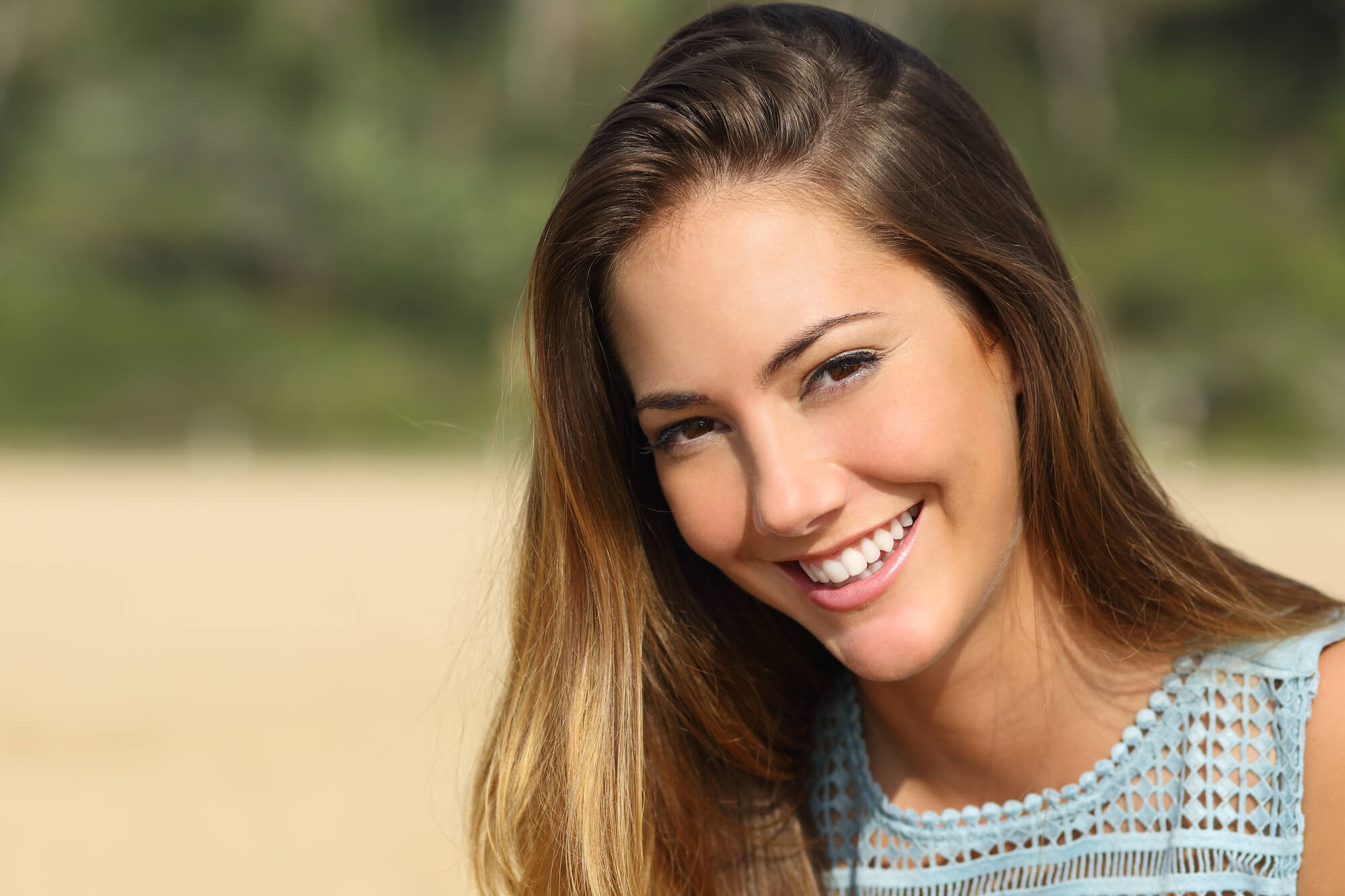 woman smiling after visiting her Cosmetic Dentist Miami